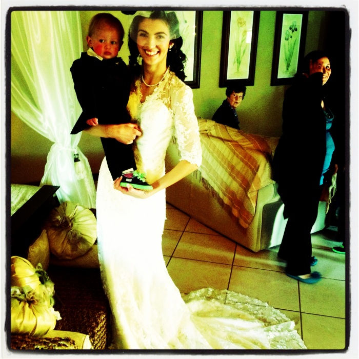 The beautiful bride, dressed and posing with her ring bearer:)