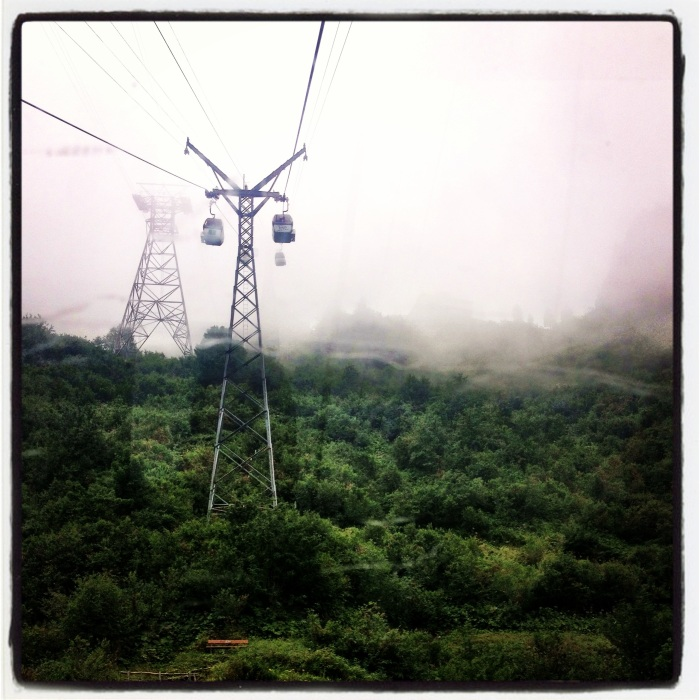 Cable cars disappearing into the clouds